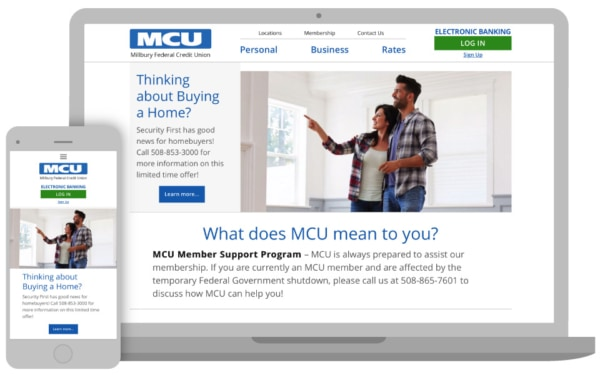 phone and laptop with credit union homepage