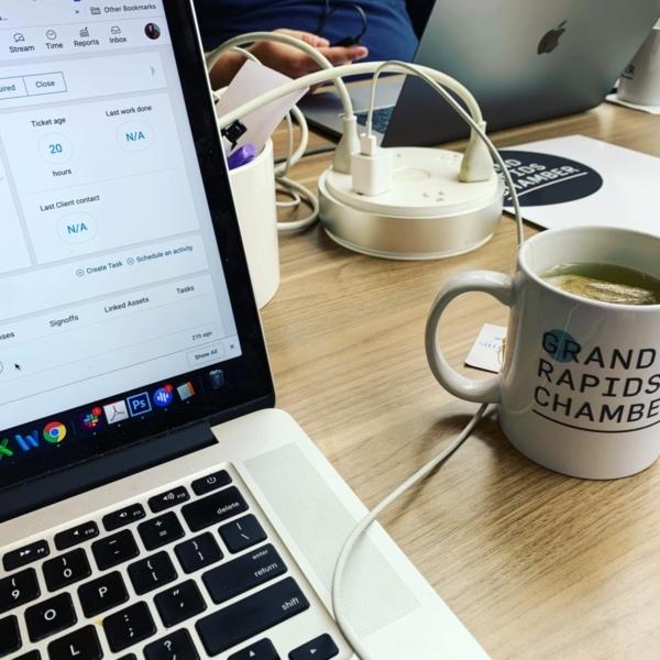 Computer with Grand Rapids Chamber Mug