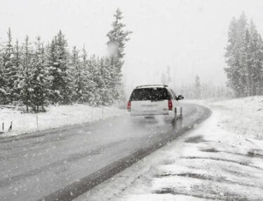 person driving in winter conditions