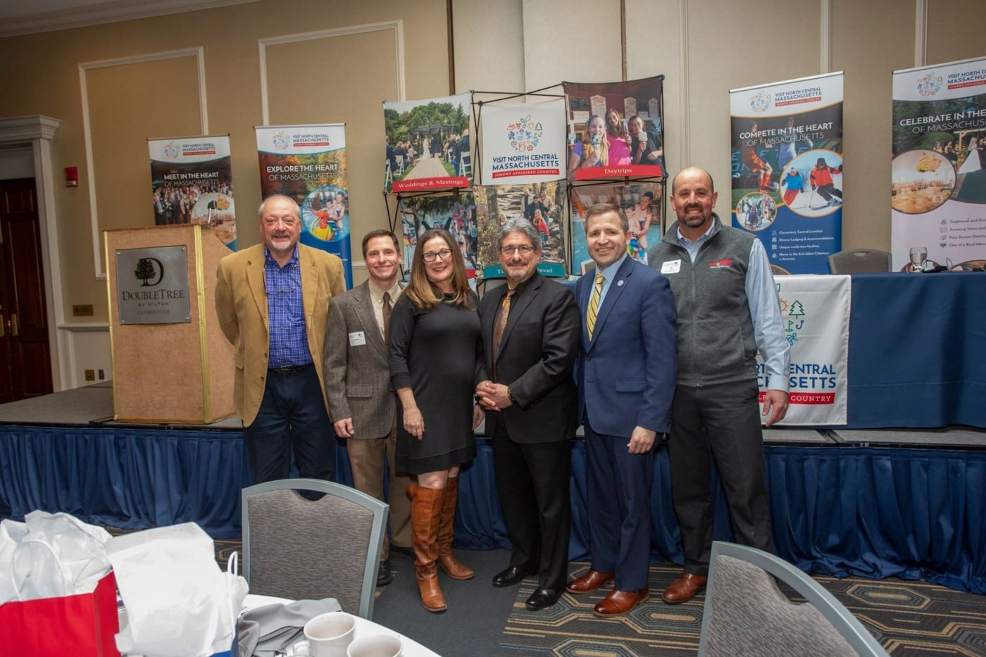 Left to right: Tony D'Agostino, Research Director for the Commonwealth of MA, Charlie Stephanini, Principal at Charles Stephanini Consulting, Lysa Miller, Partner at 3 Media Web, Fitchburg Mayor Stephen DiNatale, Roy Nascimento, President of the North Central MA Chamber of Commerce and Al Rose, owner Red Apple Farm.