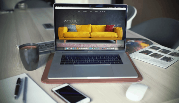 Laptop showing yellow couch for sale