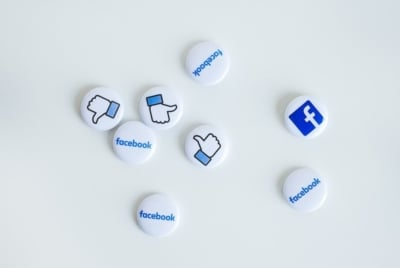 eight small buttons with Facebook logos on them