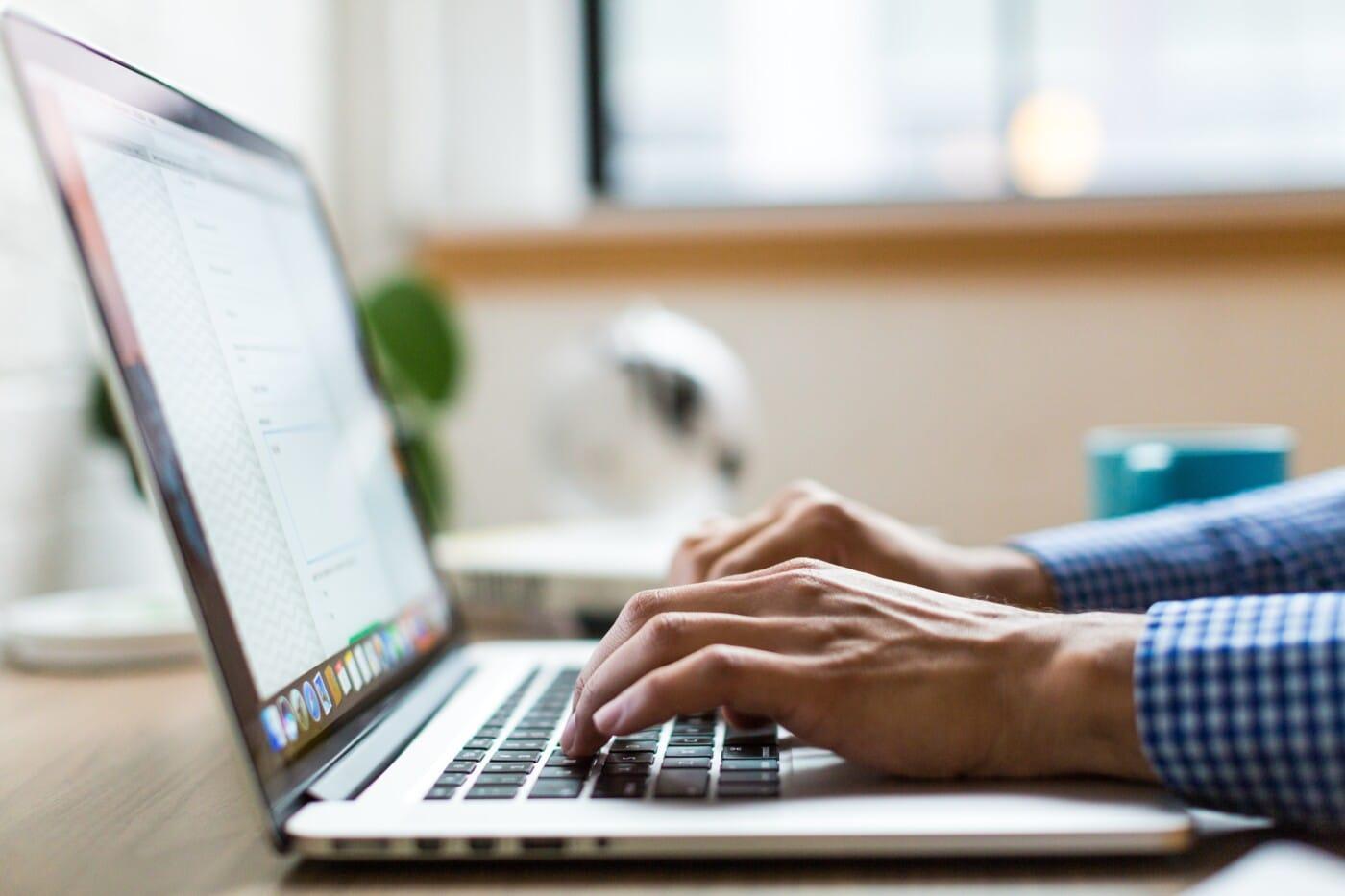 back end web developer typing on computer