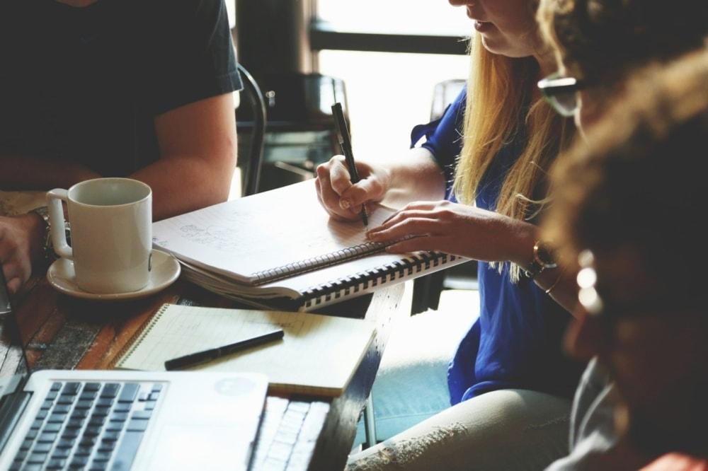 group of business people brainstorming keywords