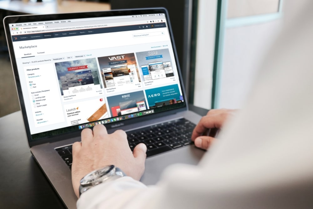 laptop computer screen showing an online marketplace with business man shopping