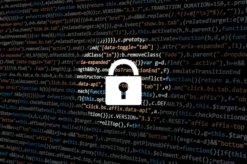 padlock on top of code as a symbol of  security measures inside the ccpa vs. gdpr