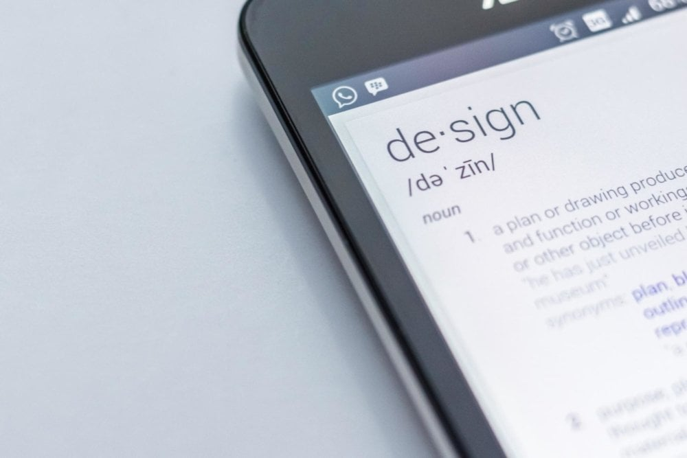smartphone with definition of b2b website design in it