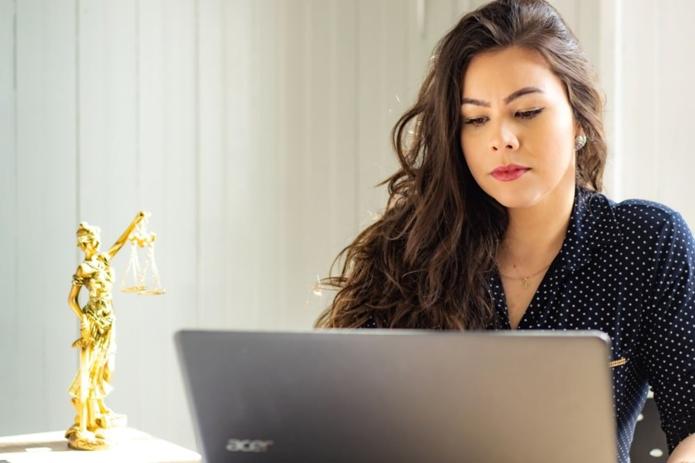 lawyer reviewing documents on computer