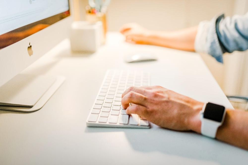 businessman typing on keyboard
