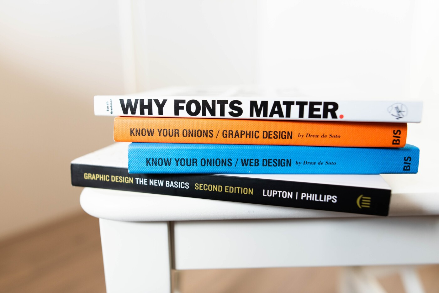 stack of books on visual elements and web design