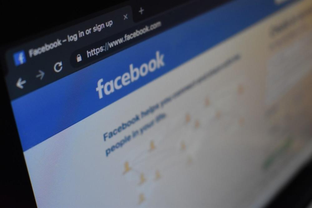 monitor display showing facebook login screen